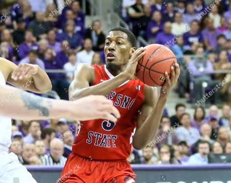 NIT basketball, tournament, NCAA, First Round, Bulldog guard Paul Watson (3) looks to pass ball to team mate during NCAA, NIT basketball game action between Fresno State Bulldogs and TCU Horned Frogs at Schollmaier Arena in Fort Worth Texas. TCU defeated Bulldogs 66-59