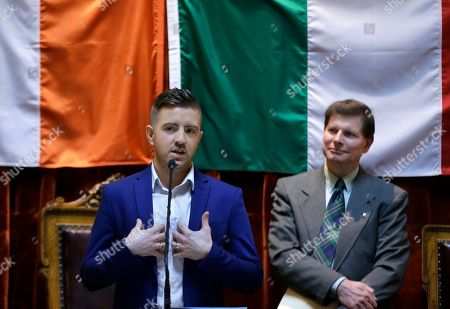 """Billy Gilman, Brian Patrick Kennedy Billy Gilman, of Richmond, R.I., a runner-up on the NBC TV show """"The Voice"""" speaks as he is honored with a resolution in the House Chambers at the Rhode Island Statehouse, in Providence. At right is State Rep. Brian Patrick Kennedy"""