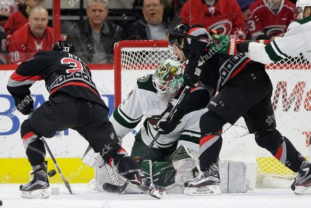 Derek Ryan, Lee Stempniak, Devan Dubnyk Carolina Hurricanes' Derek Ryan (33) and Lee Stempniak, right, try to score against Minnesota Wild goalie Devan Dubnyk during the first period of an NHL hockey game in Raleigh, N.C., . Ryan scored on the play