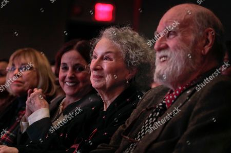 Author Margaret Atwood, second from right, listens as she is introduced for the Ivan Sandrof Lifetime Achievement Award at the National Book Critics Circle awards ceremony, in New York. Atwood was flanked by her paperback publisher LuAnn Walther, far left, editor Nan Talese, second from left, and husband Graeme Gibson