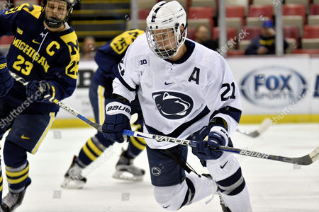 Stock Image of Penn State Nittany Lions Ricky DeRosa F (21) during NCAA hockey game in the Big Ten Tournament quarterfinal between Michigan Wolverines and Penn State Nittany Lions at Joe Louis Arena in Detroit, Michigan