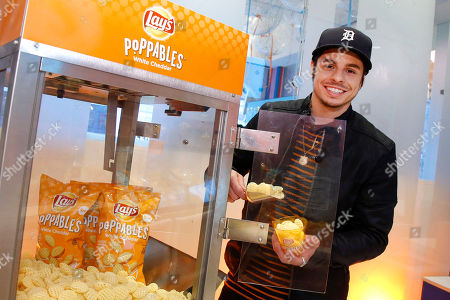 Creative director and choreographer Beau Casper Smart scoops Lay's Poppables at Dylan's Candy Bar, in New York. The event celebrated the new multidimensional potato snack, Poppables