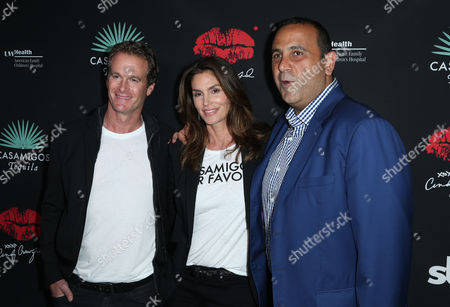 Stock Picture of Rande Gerber, Cindy Crawford and Sam Nazarian