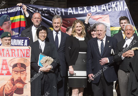 Claire Blackman (with Frederick Forsyth) outside the High Court after her husband, Marine Alexander Blackman's, conviction was reduced to manslaughter at the High Court.