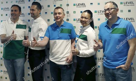 IAG group CEO Willie Walsh (C), Iberia President Luis Gallego (R), and Vueling President Javier Sanchez Prieto (L) pose with two flight attendants during the presentation of the new low-cost airline 'Level' in Barcelona, Spain, 17 March 2017. IAG group, which is the owner of British Airways (BA) and Iberia, introduced Level operated by Iberia, to enter the low-cost long-haul market. The first flights are scheduled for June 2017 with destinations Los Angeles, San Francisco, Punta Cana and Buenos Aires.