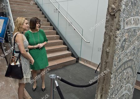 Stock Photo of 2nd Lady of the US, Mrs, Karen Pence and daughter, Charlotte Pence, look at a section of the Berlin Wall on display at the US Department of State, new US Diplomacy Center