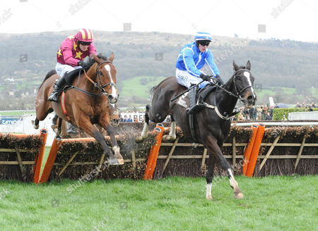 Stock Picture of Cheltenham Racecourse. Festival Day 4 The Albert Bartlett Novices' Hurdle Race. Pencil (right) ridden by Pau Townend clears the final hurdle to win from Monalee ridden by David Mullins.