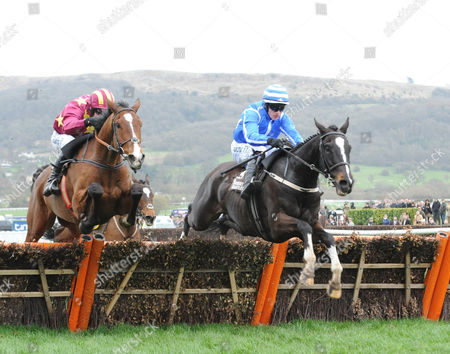 Cheltenham Racecourse. Festival Day 4 The Albert Bartlett Novices' Hurdle Race. Pencil (right) ridden by Pau Townend clears the final hurdle to win from Monalee ridden by David Mullins.