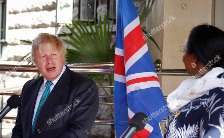 Boris Johnson, Amina Mohamed Britain's Foreign Secretary Boris Johnson, left, speaks during a joint news conference with Kenya's Foreign Affairs Cabinet Secretary Amina Mohamed, right, in Nairobi, Kenya . Johnson held bilateral talks in the capital Friday after earlier visiting the British Army Training Unit Kenya (BATUK) near Nanyuki