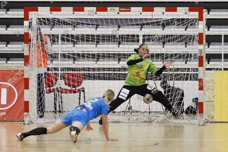 Spain's goalkeeper Silvia Navarro Gimenez (R) defends a ball sent by Romania's Anet Udristoiu (L) during the Women's friendly handball match between Romania and Spain, at Dinamo Sports Hall, in Bucharest, Romania, 17 March 2017.