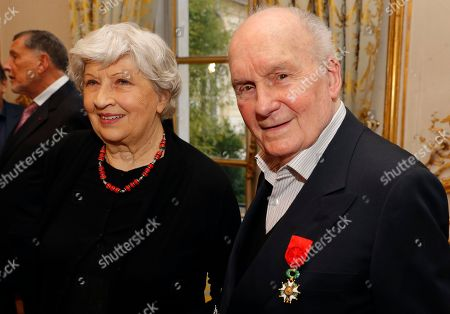 French actor Michel Bouquet and his wife Juliette Carre pose after Bouquet was awarded with the Legion d'Honneur during a ceremony at the Elysee Palace in Paris