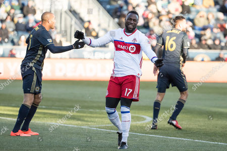 Stock Image of Jozy Altidore, Oguchi Onyewu, Richie Marquez Toronto FC's Jozy Altidore, center, reacts as Philadelphia Union's Oguchi Onyewu, left, and Richie Marquez, right, as well during the first half of an MLS soccer match, in Chester, Pa. The match ends in a 2-2 tie