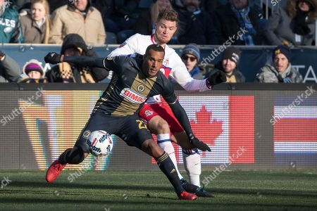 Jay Simpson, Eriq Zavaleta Philadelphia Union's Jay Simpson, left, battles for the ball with Toronto FC's Eriq Zavaleta, right, during the first half of an MLS soccer match, in Chester, Pa. The match ends in a 2-2 tie