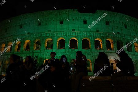 The Colosseum is illuminated with green lights during celebrations of St. Patrick day, in Rome, . This holiday is celebrated every year on March 17th honoring the Irish patron saint, St. Patrick