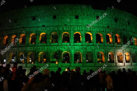 The Colosseum is illuminated in green during celebrations of St. Patrick day, in Rome