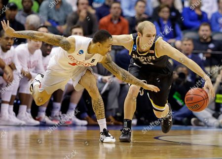 Conner Frankamp, Kyle Davis Wichita State guard Conner Frankamp (33) and Dayton guard Kyle Davis (3) go for a loose ball during the second half of a first-round game in the men's NCAA college basketball tournament in Indianapolis, . Wichita State defeated Dayton 64-58
