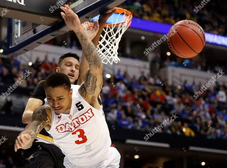 Dayton's Kyle Davis (3) is fouled on his way to the basket by by Wichita State's Landry Shamet rear during the second half of a first-round game in the men's NCAA college basketball tournament, in Indianapolis. Wichita State won 64-58