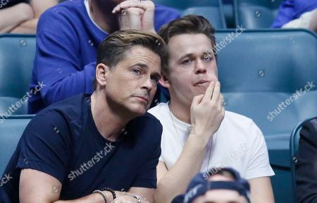 Rob Lowe, John Owen Lowe Rob Lowe, left, watches a first-round game between Michigan State and Miami with his son, John Owen Lowe, right, in the men's NCAA college basketball tournament in Tulsa, Okla