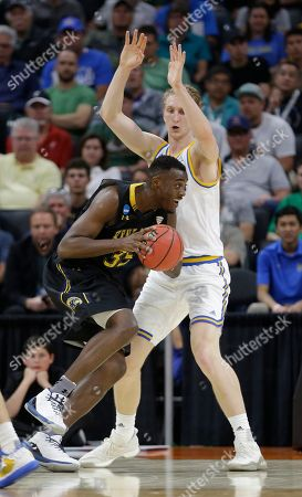 Jimmy Hall, Thomas Welsh UCLA center Thomas Welsh, right, guards Kent State forward Jimmy Hall during the first half of a first-round game of the men's NCAA college basketball tournament in Sacramento, Calif