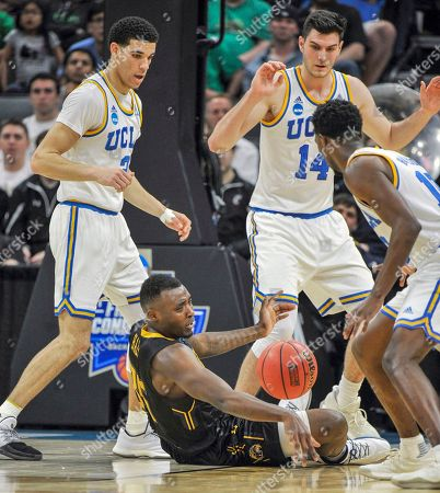 Stock Image of Lonzo Ball, Jimmy Hall, Gyorgy Goloman Kent State forward Jimmy Hall, center, tries to grab the ball between UCLA's Lonzo Ball, left, Gyorgy Goloman and Isaac Hamilton, right, during the second half of a first-round game of the men's NCAA college basketball tournament in Sacramento, Calif., . UCLA won 97-80