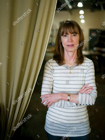 """Author Lisa See poses for photos after an interview in Santa Monica, Calif. See's 12th book, """"The Tea Girl of Hummingbird Lane,"""" will be released on Tuesday, March 21"""