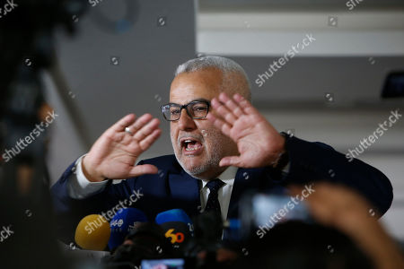 Former Morocco's Prime Minister Abdelilah Benkirane arrives at an extraordinary session of the National Council of the Islamist Justice and Development Party, known as the PJD, in Sale near Rabat, Morocco, . Morocco's king named Saadeddine Othmani as new prime minister on Friday, giving him the responsibility to form a new government
