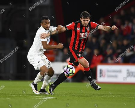 Jordan Ayew of Swansea City left vies with Charlie Daniels of AFC Bournemouth during AFC Bournemouth vs Swansea City, Premier League Football at the Vitality Stadium on 18th March 2017