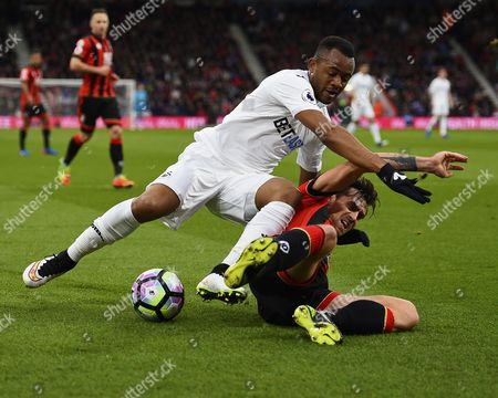 Jordan Ayew of Swansea City and Charlie Daniels of AFC Bournemouth tangle during AFC Bournemouth vs Swansea City, Premier League Football at the Vitality Stadium on 18th March 2017