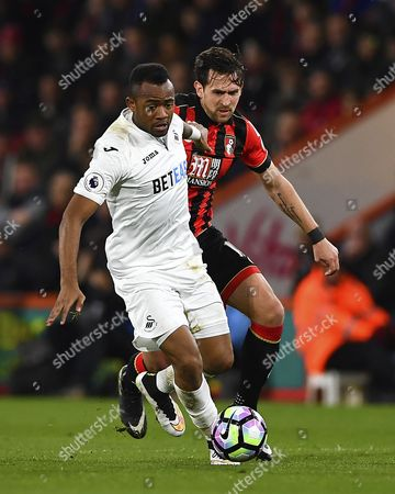 Jordan Ayew of Swansea City holds off Charlie Daniels of AFC Bournemouth during AFC Bournemouth vs Swansea City, Premier League Football at the Vitality Stadium on 18th March 2017