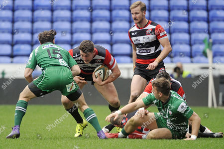 Alex Dancer of Cornish Pirates charges Ben Ransom of London Irish during the Greene King IPA Championship Match between London Irish and Cornish Pirates on March 18th at the Madejski Stadium, Reading, Berkshire.