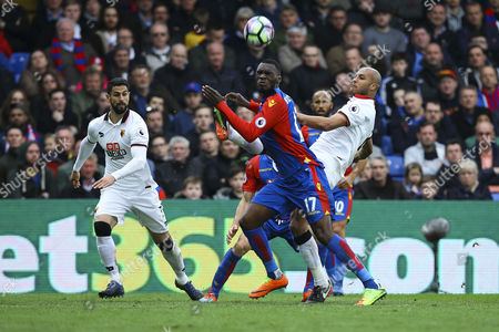Younes Kaboul of Watford clears the ball under pressure fro Christian Benteke of Crystal Palace