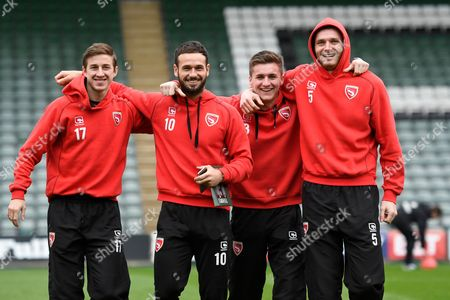 Andrew Fleming (17) Morecambe, Lee Molyneux (10) Morecambe, Peter Murphy (8) Morecambe and Ryan Edwards (5) Morecambe on the pitch at Home Park before the EFL Sky Bet League 2 match between Plymouth Argyle and Morecambe at Home Park, Plymouth