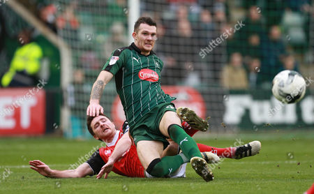 Plymouth's Jimmy Spencer is tackled by Morecambe's Peter Murphy during the Sky Bet League 2 match between Plymouth Argyle and Morecambe on Saturday 18th March 2017 at Home Park, Plymouth, Devon