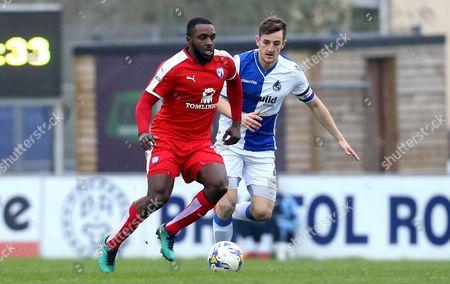 Sylvan Ebanks-Blake of Chesterfield is put under pressure by Tom Lockyer of Bristol Rovers