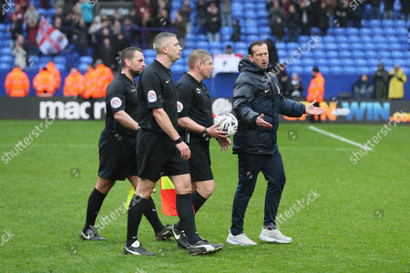Northampton Town manager Justin Edinburgh protest to referee Richard Clark after the Sky Bet League One match between Bolton Wanderers and Northampton Town played at the Macron Stadium, Bolton on 18th March 2017