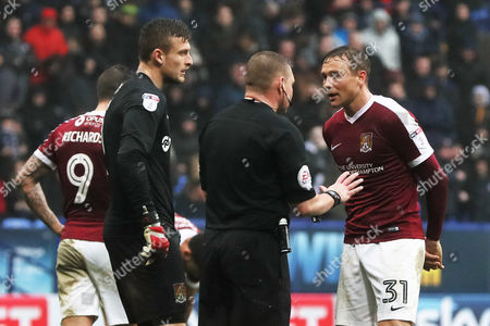 Matthew Taylor of Northampton Town protests to referee Richard Clark after giving away a penalty during the Sky Bet League One match between Bolton Wanderers and Northampton Town played at the Macron Stadium, Bolton on 18th March 2017