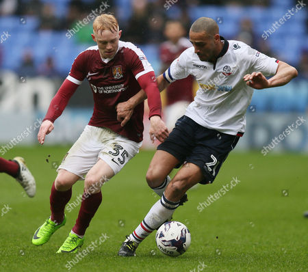 Luke Williams of Northampton Town and Darren Pratley of Bolton Wanderers during the Sky Bet League One match between Bolton Wanderers and Northampton Town played at the Macron Stadium, Bolton on 18th March 2017