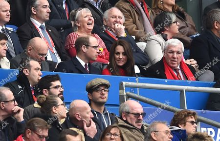 Prince William and Catherine Duchess of Cambridge with Welsh Rugby Union President Dennis Gethin (right).