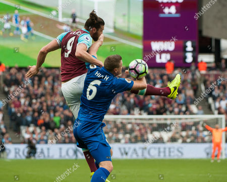 Andy Carroll of West Ham battles with Matthew Upson of Leicester City.  English Premier League London Stadium, London,  Britain 18th March 2017.