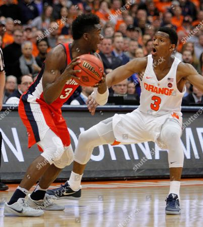 Andrew White III, Terence Davis Mississippi's Terence Davis, left, looks to pass being guarded by Syracuse's Andrew White III, right, in the second half of an NCAA college basketball NIT game in Syracuse, N.Y., . Mississippi won 85-80