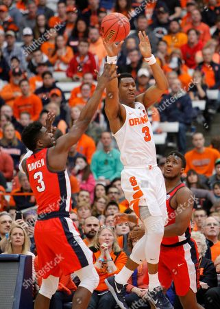 Andrew White III, Terence Davis, Deandre Burnett Syracuse's Andrew White III, center, passes over Mississippi's Terence Davis, left, and Mississippi's Deandre Burnett, right, in the first half of an NCAA college basketball NIT game in Syracuse, N.Y