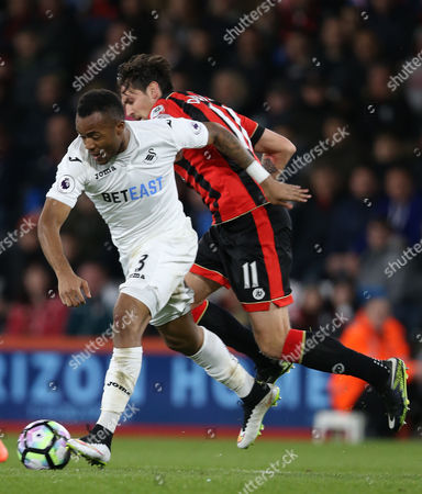 Jordan Ayew of Swansea City and Charlie Daniels of Bournemouth during the Premier League match between Bournemouth v Swansea City played at Vitality Stadium, Bournemouth on 18th March 2017