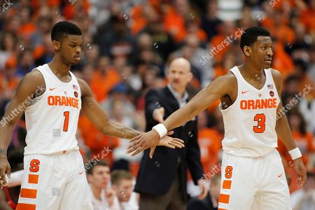 Frank Howoard, Andrew White III Syracuse's Frank Howard, left, and Andrew White III, right, hit hands in the second half of an NCAA college basketball NIT game against Mississippi in Syracuse, N.Y., . Mississippi won 85-80