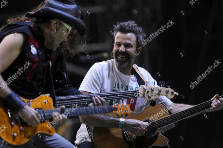 Pau Dones, right, vocalist of Jarabe de Palo from Spain, performs at the 18th edition of the Vive Latino music festival in Mexico City, . The Vive Latino Festival has become Latin America's biggest Latin rock celebration
