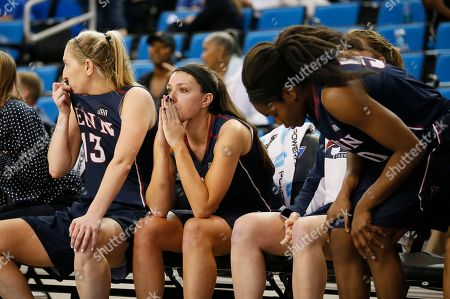 Jackie Falconer, Kasey Chambers Penn forward Jackie Falconer, center, and Penn guard Kasey Chambers, left, sit on the bench late in the second half of a first-round game against Texas A&M in the NCAA women's college basketball tournament, in Los Angeles. Texas A&M won 63-61