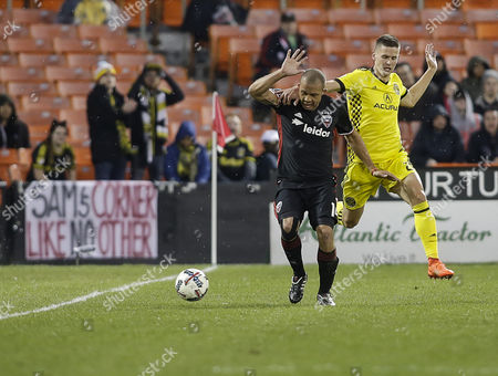 Columbus Crew SC Defender #21 Alex Crognale and D.C. United Midfielder #14 Nick DeLeon get tangled up during an MLS soccer match between the D.C. United and the Columbus Crew SC at RFK Stadium in Washington DC. Columbus Crew SC defeats DC United, 2-0