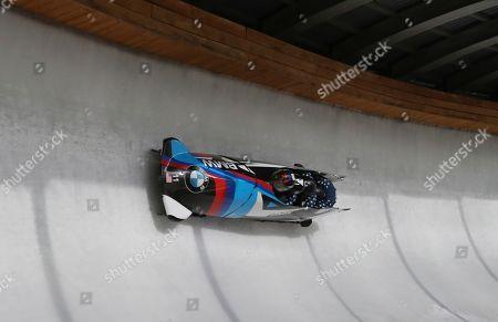 Stock Photo of Steven Holcomb, Carlo Valdes, James Reed and Samuel McGuffie from the United States speed down the track during the first run of the 4-man Bobsleigh World Cup competition at the Alpensia Sliding Centre in Pyeongchang, South Korea