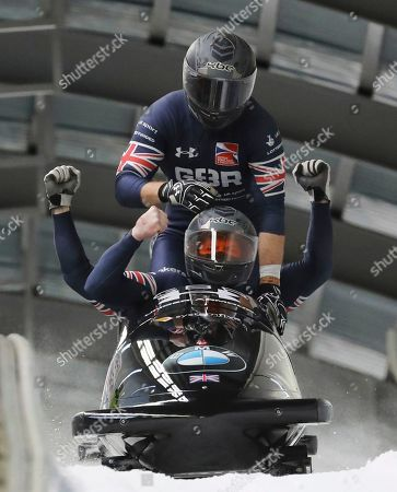 Great Britain's Bradley Hall, Bruce Tasker, Samuel Blanchet and Gregory Cackett react after the second run of the 4-man Bobsleigh World Cup competition at the Alpensia Sliding Centre in Pyeongchang, South Korea
