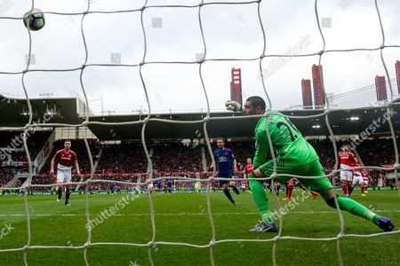 Middlesbrough goalkeeper Victor Valdes (26) watches helplessly as Manchester United midfielder Jesse Lingard (14) scores a goal  to make the score 0-2 during the Premier League match between Middlesbrough and Manchester United at the Riverside Stadium, Middlesbrough
