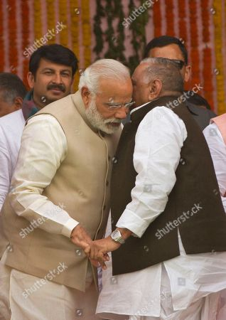 Indian Prime Minister Narendra Modi, left, listens to Samajwadi party leader Mulayam Singh Yadav during the swearing in of Yogi Adityanath as Uttar Pradesh state chief minister in Lucknow, India